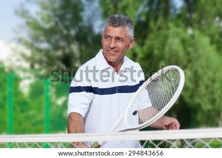 man playing tennis - stock photo