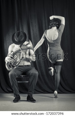 Man playing the trumpet, and a woman dancing. Retro style.