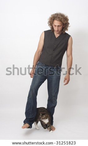 Man playing with a cat on white background