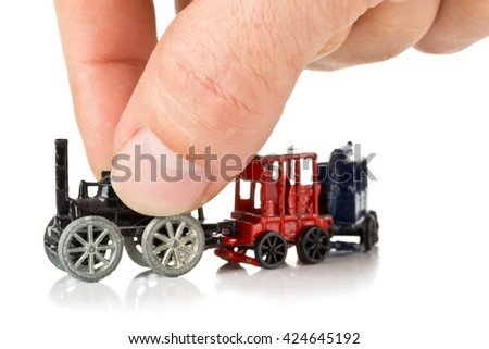 Man playing with old metal toy train with locomotive and wagons over white background - stock photo