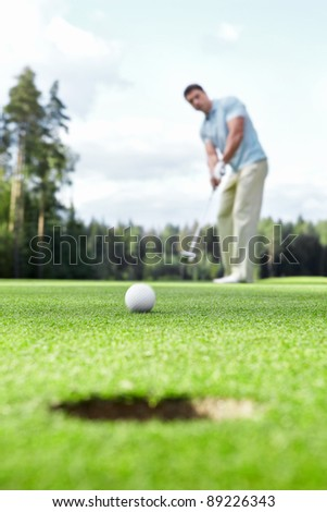 Man plays golf on the golf course - stock photo