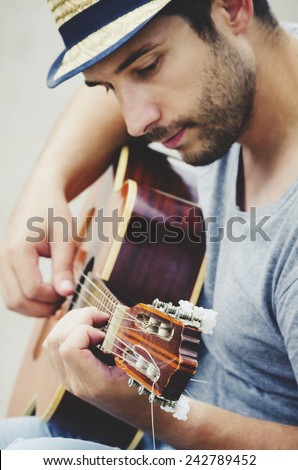 man plays the guitar on the street. retro style.