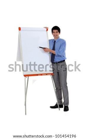 Man pointing at flip chart with pen - stock photo
