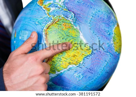 Man pointing at the continent. Far-far away. Welcome to South America. A continent amidst the ocean. - stock photo
