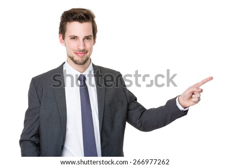 Man pointing showing copy space isolated on white background - stock photo