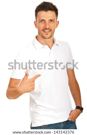 Man pointing to empty space of his t-shirt isolated on white background - stock photo