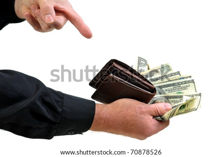 Man pointing to money and wallet presenting all he has with him. - stock photo