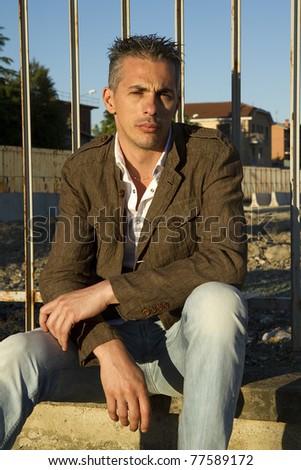 Man posing in brown jacket - stock photo