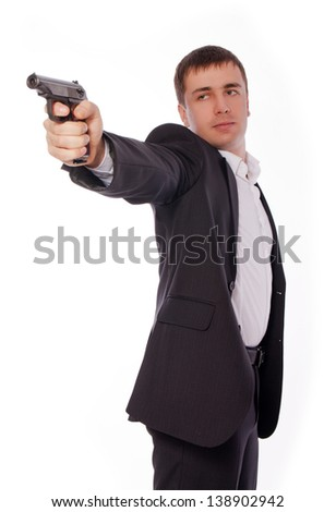 Man posing james bond like with a gun. Isolated on white