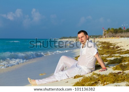 Man posing on the beach of Caribbean Sea