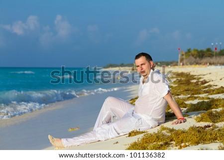 Man posing on the beach of Caribbean Sea - stock photo