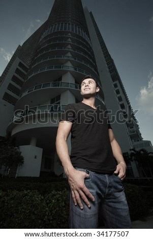 Man posing with a building in the background - stock photo