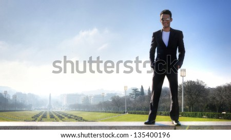 Man posing with the panorama of Eduardo VII Park in Lisbon, Portugal