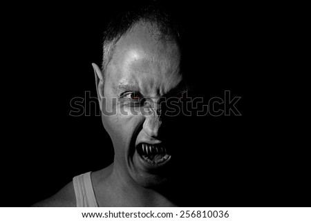 man possessed by demon. black and white - stock photo