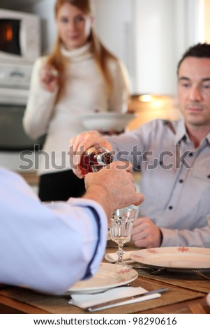Man pouring wine - stock photo
