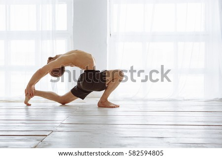 Man Practicing Advanced Yoga A Series Of Poses Lifestyle Concept