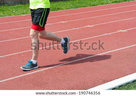 Man practicing the jogging on sport of running track