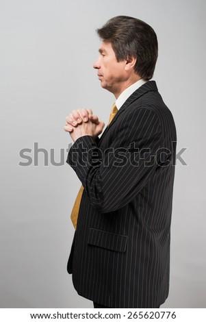 man pray his god - stock photo