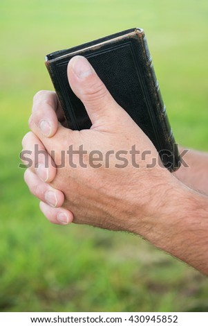 Man praying outside - stock photo