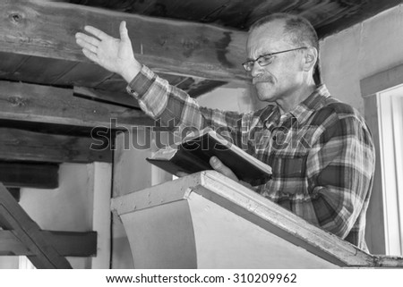 man preaching from the pulpit - stock photo