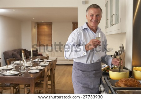 Man Preparing Food For A Dinner Party