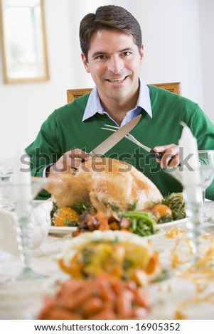 Man Preparing To Carve A Turkey
