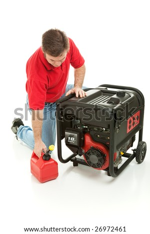Man preparing to fill his gasoline powered generator with fuel.  Isolated on white. - stock photo
