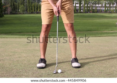 Man preparing to grip a golf club
