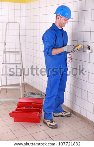 Man preparing voltmeter - stock photo