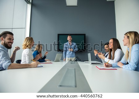 Man presenting ideas to the rest of the team. - stock photo