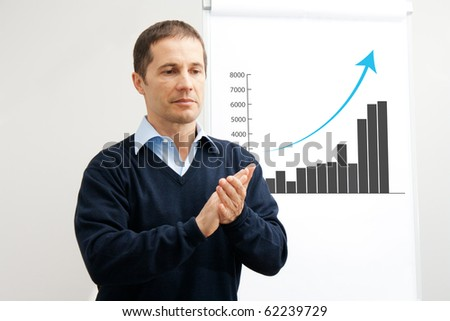 Man presenting successful business - stock photo