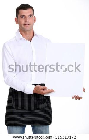 Man presenting white panel - stock photo