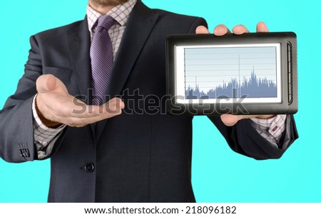 man presents a diagram on the tablet on blue background
