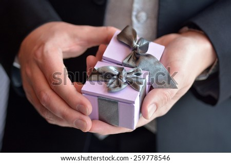 Man presents engagement rings. Concept of wedding, marriage, wealth and luxurious lifestyle - stock photo