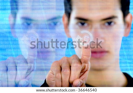 man pressing a screen button over modern background - stock photo