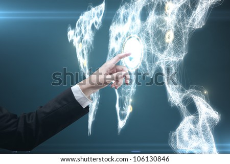man pressing a touchscreen global communications button - stock photo