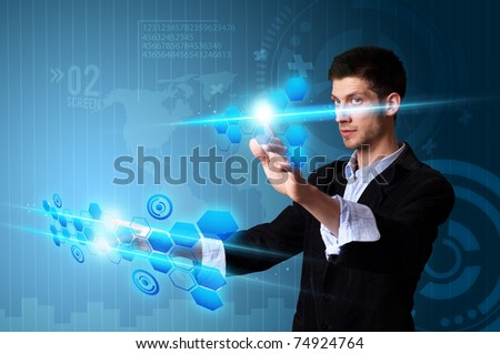 Man pressing modern touch screen buttons with a blue technology background