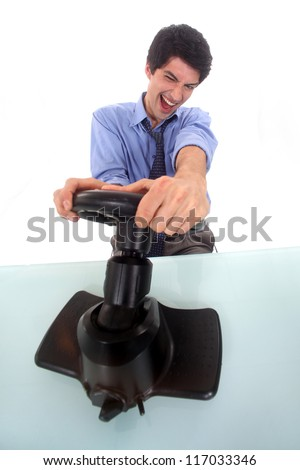 Man pretending to play a console - stock photo