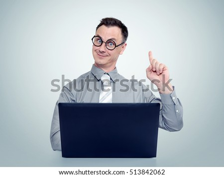 Man programmer in tie and glasses with a laptop. idea concept