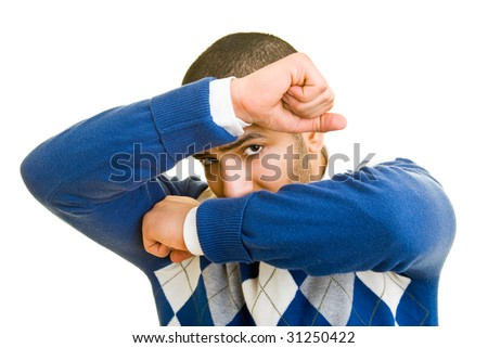 Man protecting his face with his arms - stock photo