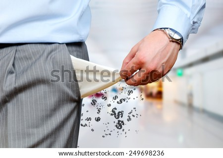 Man pulling out empty pockets - stock photo