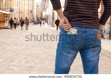 Man pulls the money from his jeans pocket, close-up - stock photo