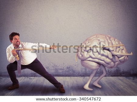 Man pulls the rope with brain drain - stock photo