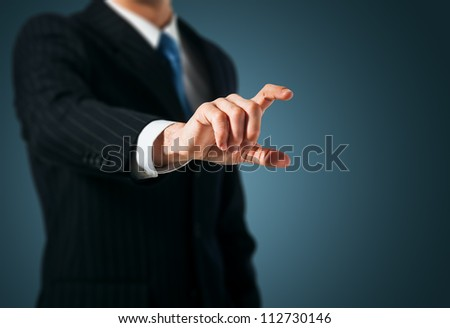 Man pushing on a touch screen interface - stock photo