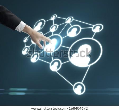 man pushing social media interface - stock photo