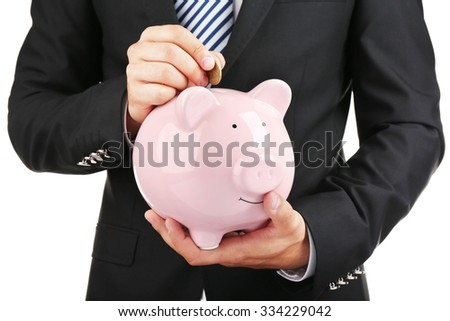 Man put coin into a piggy-bank