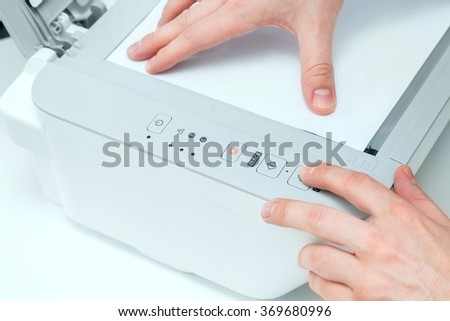 Man puts start button on scanner panel