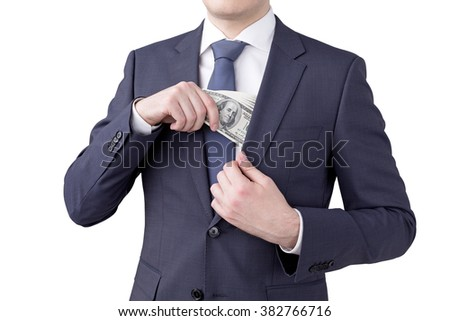 man putting a one hundred dollar banknote into the chest pocket. No head seen. Isolated. Concept of earning money. - stock photo