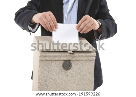 man putting letter in mailbox.Close up