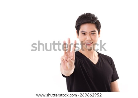 man raising, showing 3 fingers hand sign gesture - stock photo